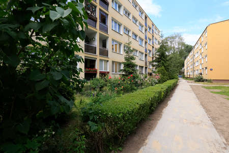 Warsaw, Poland - June 16, 2020: The Saska Kepa is an area containing a large number of houses built close together where a lot of people live and there are many decorative plants around buildings