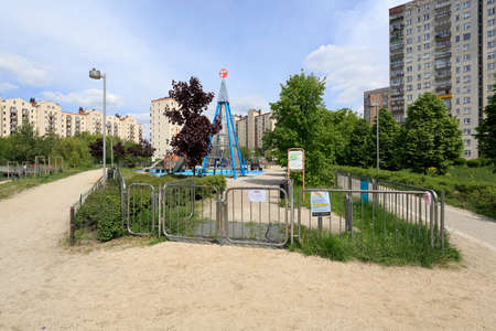 Warsaw, Poland - May 15, 2020: Large playground which is taken out of use to limit the spread of coronavirus during the outbreak. This is a part of housing estate known locally as Goclaw.