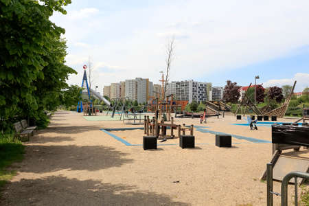 Warsaw, Poland - May 15, 2020: A large playground and all its equipment is excluded from use to limit the spread of the virus during an epidemic. This is part of a housing estate known as Goclaw.