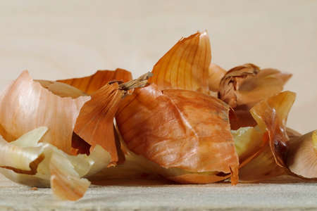 After peeling the onion, only ragged pieces of onion shells remained.