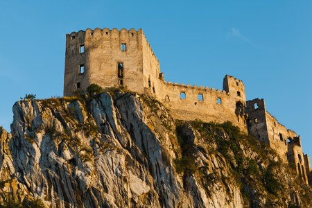 Ruins of Beckov Castle during sunset time, Slovakia. Ruined without a roof lying on a big cliff. 版權商用圖片