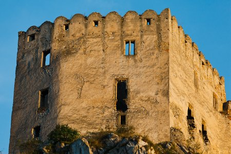 Details of Ruins of Beckov Castle during sunset time, Slovakia. Ruined without roof staying on a big cliff. Close up shot.