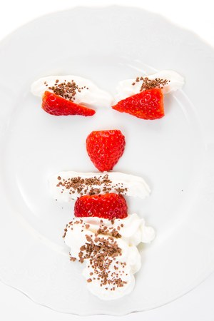 Emoticon make from strawberries saying - mind your body weight - calculate calories. 写真素材