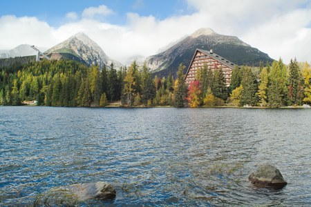 Strbske pleso mountain lake with crystal clear water and rocks in High Tatras in Slovakia.
