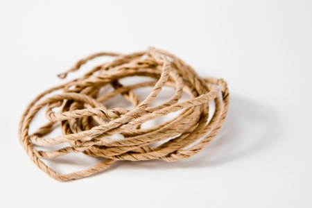 Plain twine on white background. Stock Photo