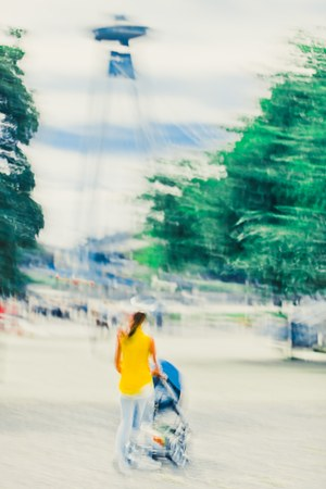 Mother in yellow dress with carriage walking in Bratislava - Abstract Expressionism Impressionism Photography Dreamy In motion