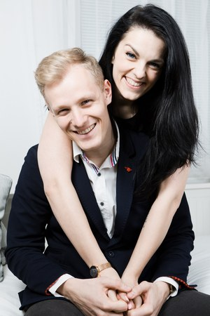 Young attractive couple in love posing together in black dresses - business portrait Reklamní fotografie