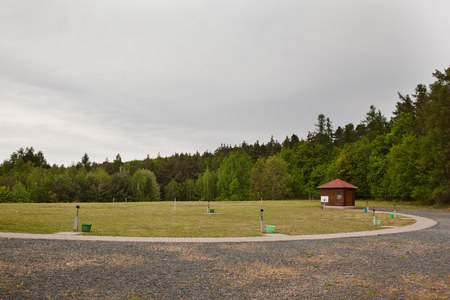 Areal of skeet shooting range during cloudy day. Forrest in background
