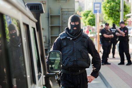 Bratislava, Slovakia, 2nd. Jun, 2016 : Police reconstruction of crime scene, special unit member in balaclava