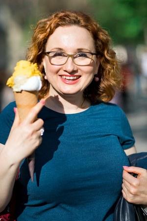 Smiling woman having big ice cream in a cornet. Stok Fotoğraf