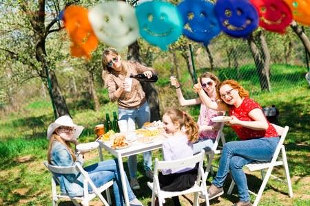 Birthday garden party during summer sunny day - preparing drinks