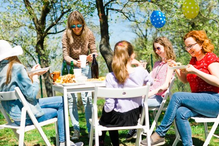Birthday garden party during summer sunny day - eating on picnic Stock Photo