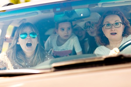 Mothers with daughters scared in car - frightened by incoming accident - fear behind the wheel