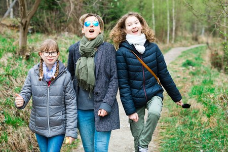 Female tourists on walking trail in th forrest - mother enjoying the trip with daughters Stock Photo