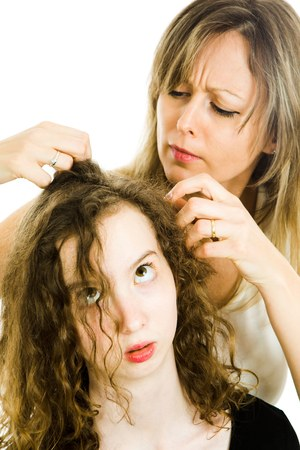 Mother checking child's head for lice - louse on head, curly hairs - white background Banque d'images - 123220283