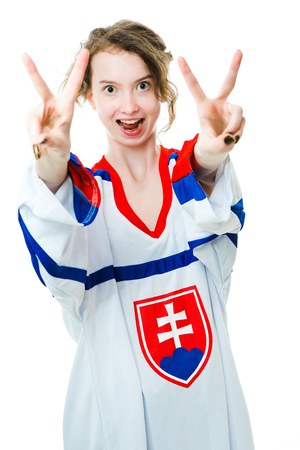 Hockey fan in jersey in national color of Slovakia cheer, celebrating goal - gestures of victory - white background