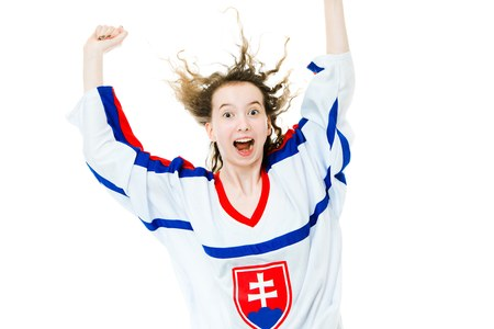 Hockey fan in jersey in national color of Slovakia cheer, jump, celebrating goal - great joy of victory - white background