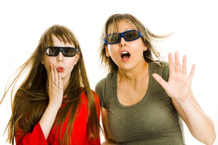 Amazed woman and girl in cinema wearing 3D glasses experiencing 5D cinema effect - scared watching performance - gestures of astonishment - concept on white background