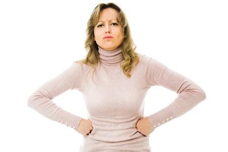 Strict housewife wearing elegant dress shoving rigorous character - white background Stock Photo