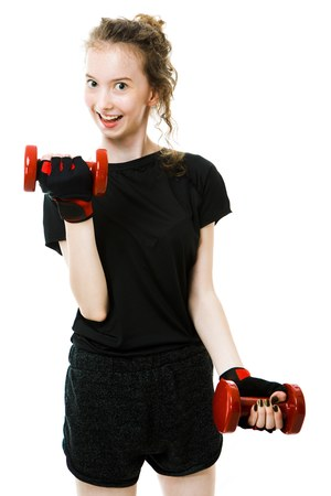 Young teenaged skinny girl having fitness straining with small weights