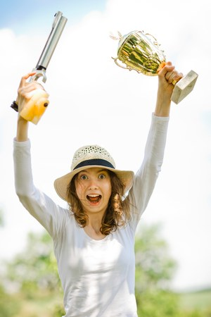 Happiness of young winner, shooter of air pistol 10 meters enjoy victory, golden trophy cup