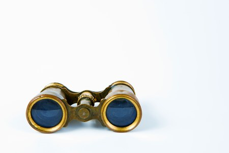 Vintage classical brass binoculars on white background, front view
