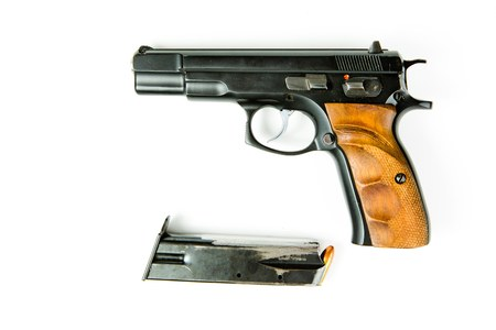 Used black semi automatic pistol and scraped magazine with ammunition