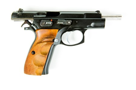 Racked black slide of handgun. Puled back pistol to cock and reload the gun Фото со стока - 124697332