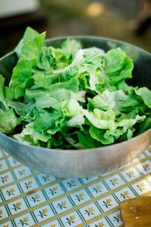 Preparing lettuce in steel bowl, vegetable food Stock Photo