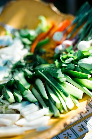 Fresh vegetable plate with sliced bio garden products