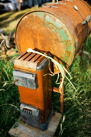 Home made oven, garden stove to prepare meat, rusty steel Stock Photo