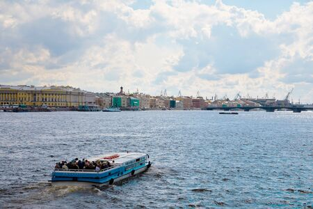 St. Petersburg, Russia - July 7, 2019: Tourists having boat trip on river Neva Редакционное