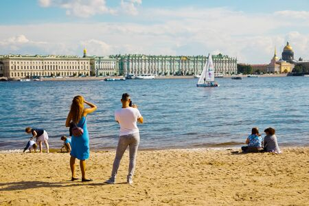 St. Petersburg, Russia - July 7, 2019: People on sand beach of Hare island Редакционное