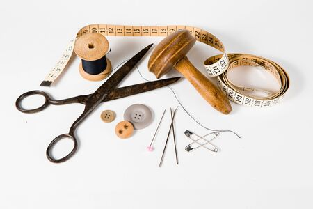 Tailor still life set, vintage tools for handmade custom tailoring industry. On white background.