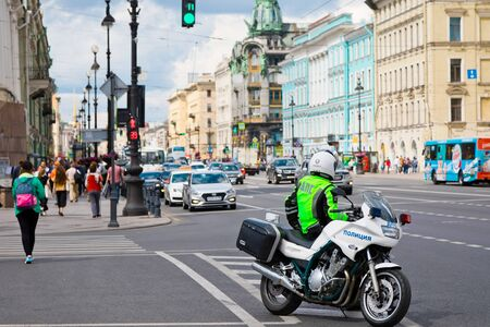St. Petersburg, Russia - July 8, 2019: Police man with motorbike on Nevsky prospect, main avenue of St. Petersburg