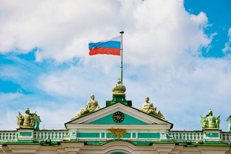 St. Petersburg, Russia - July 8, 2019: Russian tricolours flag on Hermitage Museum Редакционное