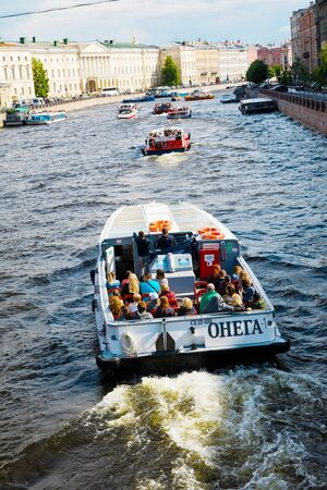 St. Petersburg, Russia - July 8, 2019: Boat traffic on city river Fontanka, tourists transportation