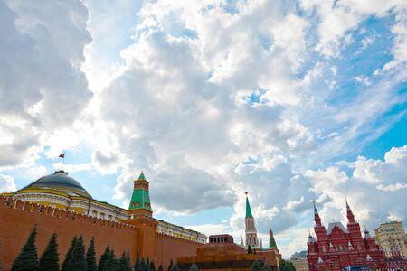 Moscow, Russia - July 9, 2019: Senatskaya Tower on Kremlin wall, Lenin's Mausoleum and Kremlin Senate behind, State Historical Museum in back