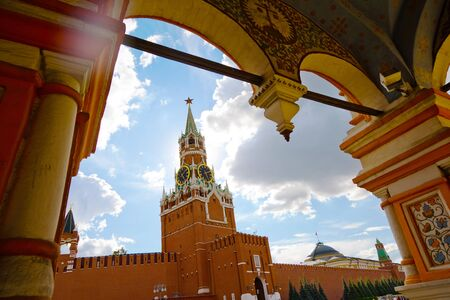 Moscow, Russia - July 9, 2019: Brick wall and Spasskaya Tower of Kremlin on Red Square, view from Cathedral of Vasily the Blessed Редакционное