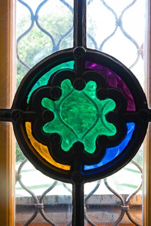 Detail of colorful Stained Glass on vintage window