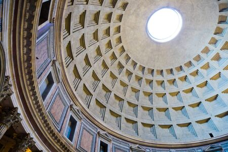Interior of Rome Pantheon with the famous ray of light from the top opening, Italy