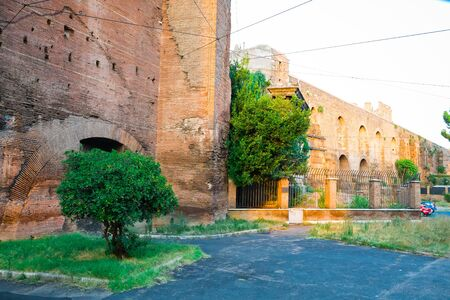 Old city brick wall in Rome, entering to historical city center