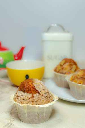 Close-up of a breakfast: three muffins, a cup, a teapot and a jar with sugar. Horizontal photography and copy space Stok Fotoğraf