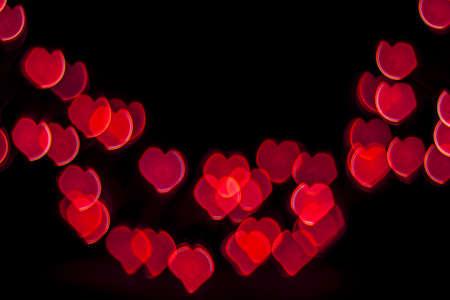 Red Heart Bokeh on black background. Valentine concept