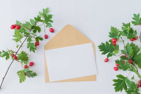 Mockup blank paper card and envelope on a white background. Flat lay, top view