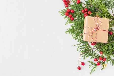 Holiday background with christmas branches and gift boxes on a light background Stock Photo