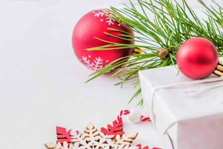 Holiday background with christmas branches and decoration on a light background Stock Photo