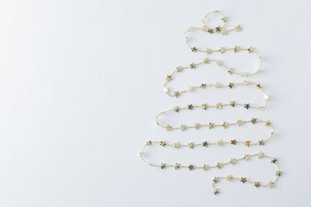Christmas and New Year gold garland on a light background Stock Photo