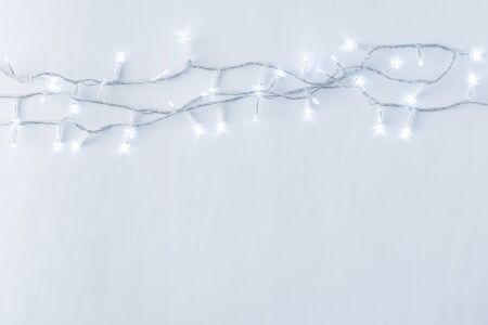 Fairy lights garland on a light background