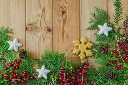 Holiday background with christmas branches and decoration on a wooden background